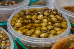 Olives in conserve in a pot. From marketplace Royalty Free Stock Image