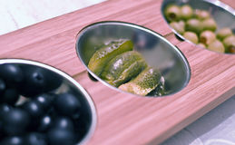 Olives and cucumbers snacks Stock Images