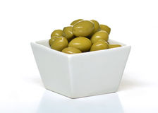 Olives in a cup. In white background Stock Photography