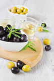 Olives on a cutting board Royalty Free Stock Image