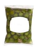 Olives dans la surface de boîte en plastique Photographie stock libre de droits