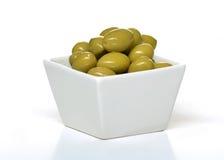 Olives dans une tasse Photographie stock