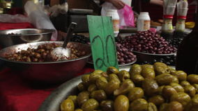 Olives on display in The Carmel Market stock video footage