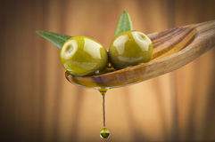 Olives with drop oil on wood spoon Stock Image