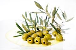 Olives et huile d'olive de plaque Image stock