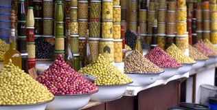 Olives on exhibitors for aperitifs and olive oil. The perfumes of the colors and craftsmanship of the markets of the eastern cities Royalty Free Stock Photo