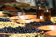 Olives at farmers market. A display of several large bowls of fresh green and black olives at a French farmer's market Royalty Free Stock Images