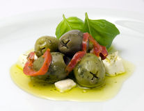 Olives and Feta. Some olives, feta, basil and olive oil Stock Photo