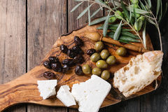 Olives with feta cheese and bread Stock Images