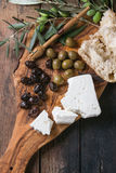 Olives with feta cheese and bread Stock Photography