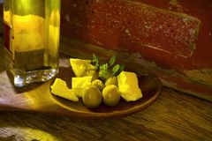 Olives,feta cheese and olive oil Royalty Free Stock Images