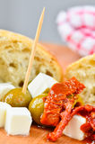 Olives, feta cheese and sundried tomatoes Stock Photos