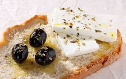 Olives and fresh cheese in a slice of bread Stock Photography
