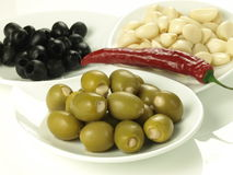 Olives and garlic Stock Images