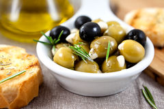 Olives with garlic and herbs Stock Photos