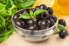 Olives. In a glass saucer Royalty Free Stock Photo