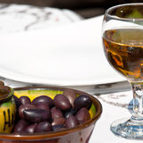 Olives with glass of wine Stock Photos