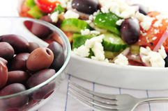 Olives and greek salad Royalty Free Stock Images