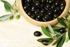 Olives with green leaf on background Stock Images