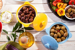 Olives and Grilled Vegetable Dish on Picnic Table Royalty Free Stock Images