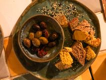 Olives with Homemade Crispy Bread Slices and Sesame Seeds on Appetizer Plate. stock photo