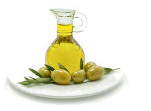 Olives and jar of olive oil on white Royalty Free Stock Photos