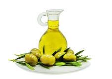 Olives and jar of olive oil on white Stock Photos