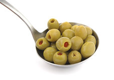 Olives ladle. Olives stuffed peppers in metal ladle Royalty Free Stock Photo