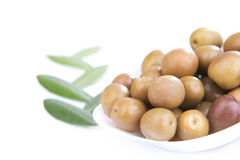 Olives with leafs. Olives and leafs with white background Stock Image