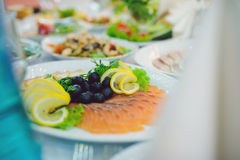 Olives, Lemon and Red Fish Royalty Free Stock Image