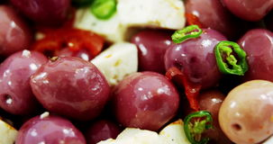 Olives marinated with herbs and spices stock video