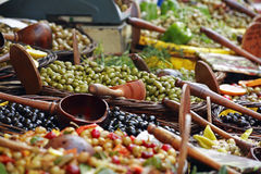 Olives at market. A large display of a variety of olives for sale at a market Stock Photo