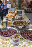 Olives on a market Stall. Black and Green Olives on a slow food market stall in a local food produce market stock image