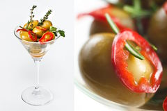 Olives in Martini Glass. Green olives and sliced red chili peppers in a martini glass stock images