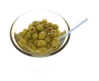 Olives in martini glass with straw Stock Image