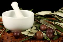 Olives, Mortar And Pestle Royalty Free Stock Photography