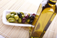 Olives and oil. Mixed olives in oil on a plate Royalty Free Stock Photos
