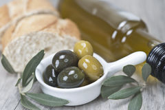 Olives with oil and bread Stock Photo