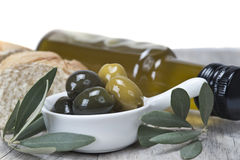 Olives with oil and bread Royalty Free Stock Photography