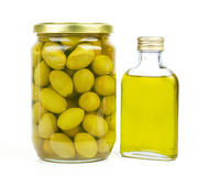 Olives and oil close up on the white Stock Photo