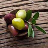 Olives on old wooden table. Royalty Free Stock Photography