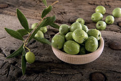 Olives on an old wooden table Royalty Free Stock Images