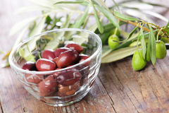 Olives and olive branch. Olives in the bowl and olive branch Royalty Free Stock Photography