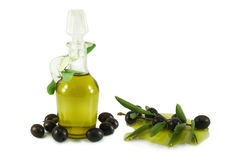 Olives, olive branch and olive oil. In a bottle Stock Photography