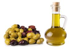 Olives and olive oil. Isolated on white background Stock Image