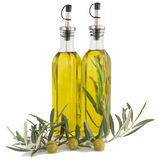 Olives and olive oil. Olives and olive oil with a branch of an olive tree on a white background Stock Photo