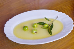 Olives with olive oil Stock Image