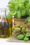 Olives, olive oil and basil Royalty Free Stock Photography