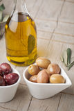 Olives and olive oil bottle Stock Photos