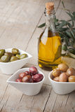 Olives and olive oil bottle Royalty Free Stock Photo